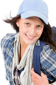 Smiling female teenager wear cool outfit schoolbag — Stock Photo