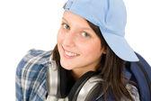 Smiling teenager girl enjoy music with headphones — Stock Photo