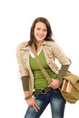 Student teenager girl with schoolbag posing — Stock Photo