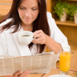 Breakfast at home happy woman read newspapers — Stock Photo #7357349