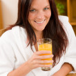 Breakfast - Smiling woman with fresh orange juice — Stock Photo
