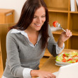 Home working lunch smiling woman with laptop — Stock Photo