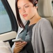 Executive woman manager sitting in car calling - Stockfoto