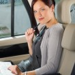 Stock Photo: Executive businesswoman work laptop car backseat