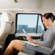 Executive businesswoman in car work touch tablet — ストック写真