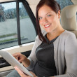 Executive businesswoman in car work touch tablet — Stock Photo