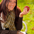Autumn attractive woman eat apple sunset park — Stock Photo