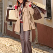 Autumn outfit shopping woman elegant with bags - Stok fotoğraf