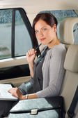 Executive businesswoman work laptop car backseat — Stockfoto
