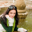 Autumn park bench young woman hold phone — Stock Photo #7486064
