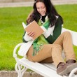 Autumn park bench young woman read book — Stock Photo