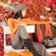 Autumn park bench young woman with pumpkins — Stock Photo #7486081