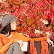 Autumn fashion young woman relax on bench — Stock Photo