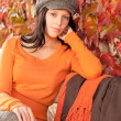 Autumn fashion portrait young woman relax bench — Stock Photo