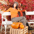 Autumn park bench young woman with pumpkins — Photo