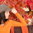 Autumn park bench young woman relaxing — Stockfoto