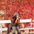 Autumn park bench young woman relaxing — Stock Photo #7486108