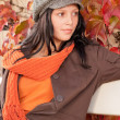 Autumn park bench young woman relaxing — Stock Photo #7486112