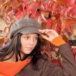 Autumn park bench young woman relaxing — Foto de Stock