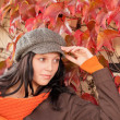 Autumn park bench young woman relaxing — Stock Photo #7486113
