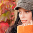 Stock Photo: Autumn leaves portrait of beautiful female model