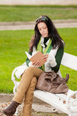 Autumn park bench young woman read book — Stockfoto