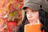 Autumn leaves portrait of beautiful female model — Stock Photo