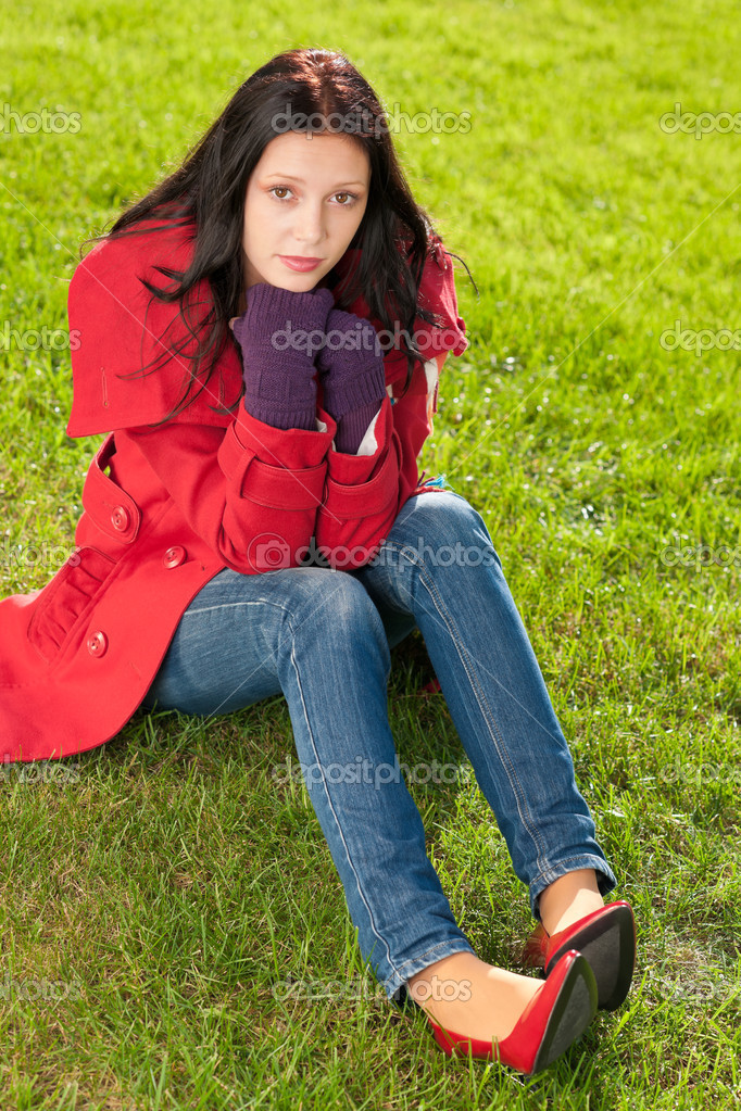 Winter outfit portrait of beautiful female model sitting green grass  Stock Photo #7486160