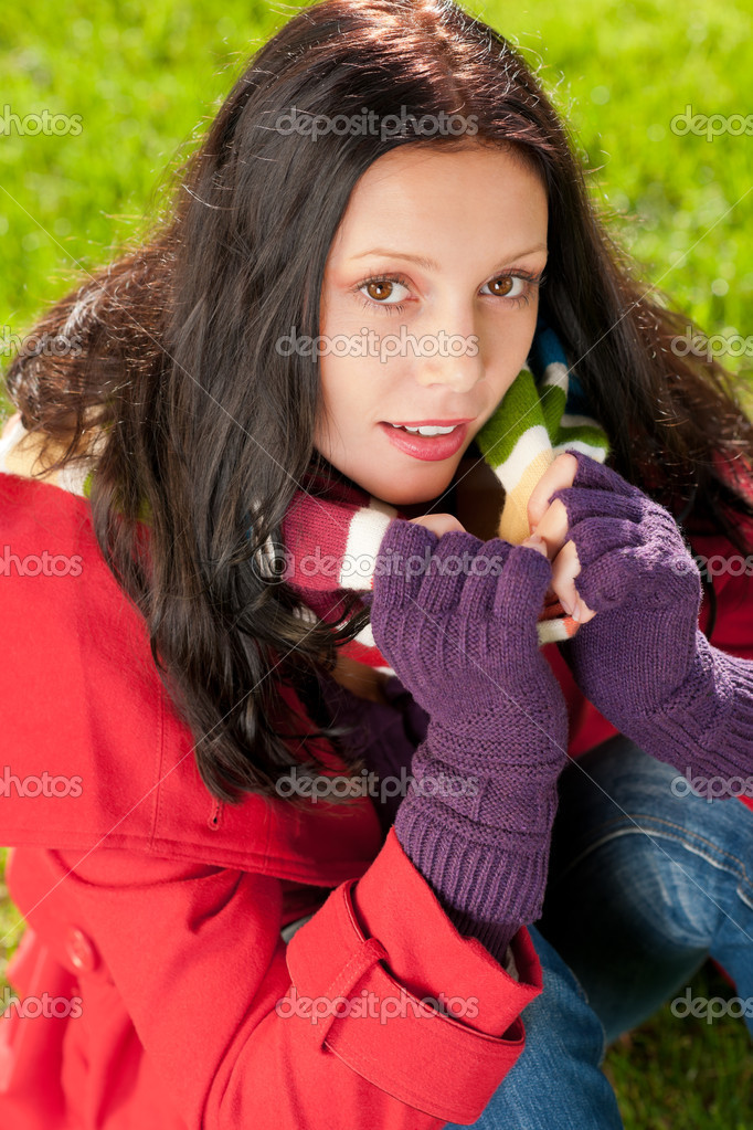 Winter outfit portrait of beautiful female model sitting green grass — Stock Photo #7486162