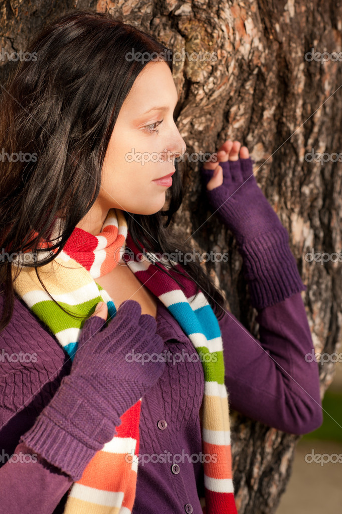 Winter outfit portrait of beautiful female model posing by tree bark  Stock Photo #7486166