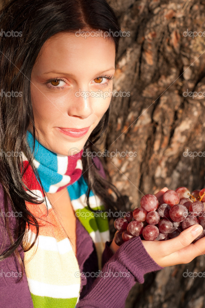 Winter outfit portrait of beautiful female model posing with grapes — Stock Photo #7486170