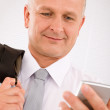 Stock Photo: Mature businessman hold phone close-up portrait