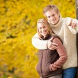 Autumn romantic couple smiling together in park — Stock Photo #7609604