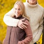 Autumn love couple hugging happy in park — Stock Photo #7609608
