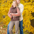 Autumn love couple hugging happy in park - Stock Photo