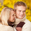 Autumn happy couple hugging together park scenery - Stock Photo