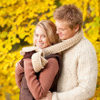 Autumn romantic couple happy hugging in park — Stockfoto #7609663