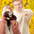 Stock Photo: Autumn couple take photo camerin park
