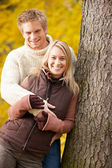 Autumn love couple hugging happy in park — Stock Photo