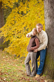 Autumn romantic couple smiling together in park — Stock Photo