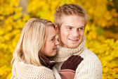 Autumn happy couple hugging together park scenery — Stock Photo