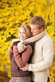 Autumn romantic couple happy hugging in park — Stock Photo
