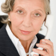 Senior businesswoman on phone close-up portrait — Stock Photo