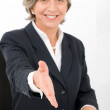 Senior businesswoman handshake close deal smiling — Stock Photo