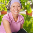 Stock Photo: Senior sportive womsmiling outside portrait