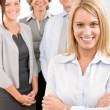 Business team young woman with mature colleagues — Stock Photo