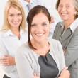 Business team young woman with mature colleagues - Stock Photo