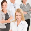 Business team young woman with mature colleagues - Foto Stock