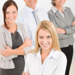 Business team young woman with mature colleagues - Stockfoto