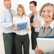 Business team senior woman with happy colleagues — Stock Photo